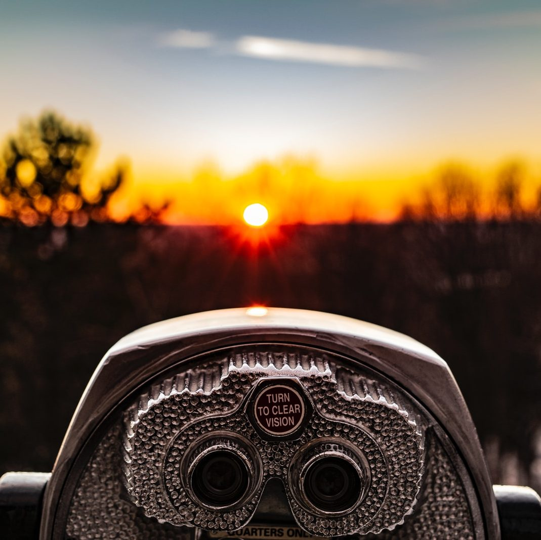 selective focus photo of silver tower viewer telescope facing sunshine